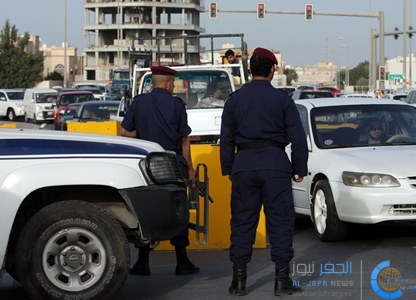 In this photo taken during a visit organized by Bahrain's Interior Ministry, Bahrain police stop vehicles at a checkpoint  in the central city of Riffa, Bahrain Monday, March 28, 2011. (AP Photo/Hasan Jamali)